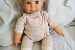 FREE!  Sweet Baby Doll. She talks baby talk and blinks her eyes.